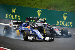 Felipe Nasr, Sauber C35 and Jenson Button, McLaren MP4-31 battle for position