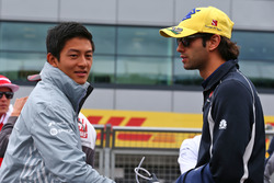 (L to R): Rio Haryanto, Manor Racing with Felipe Nasr, Sauber F1 Team on the drivers parade
