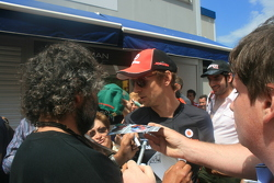 Jenson Button doing autographs