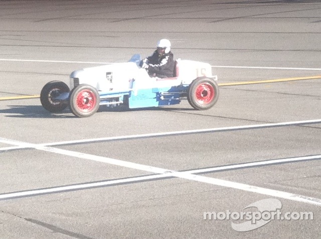 Vintage Indy Roadster exits Fontana
