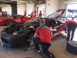 Crew Chief Bill Barrett checks the settings on one of the Scuderia Corsa Ferrari's