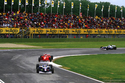 Jacques Villeneuve, Williams FW19 Renault and Michael Schumacher, Ferrari F310B