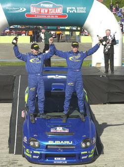 Richard Burns celebrates on the podium