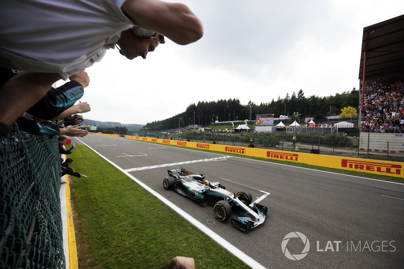 Lewis Hamilton, Mercedes AMG F1 W08, race winner, takes the chequered flag for victory