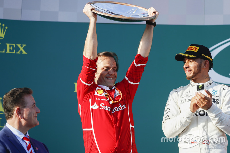 Luigi Fraboni, Head of Power Unit Race Operation, Ferrari, lifts the Constructors trophy for Ferrari