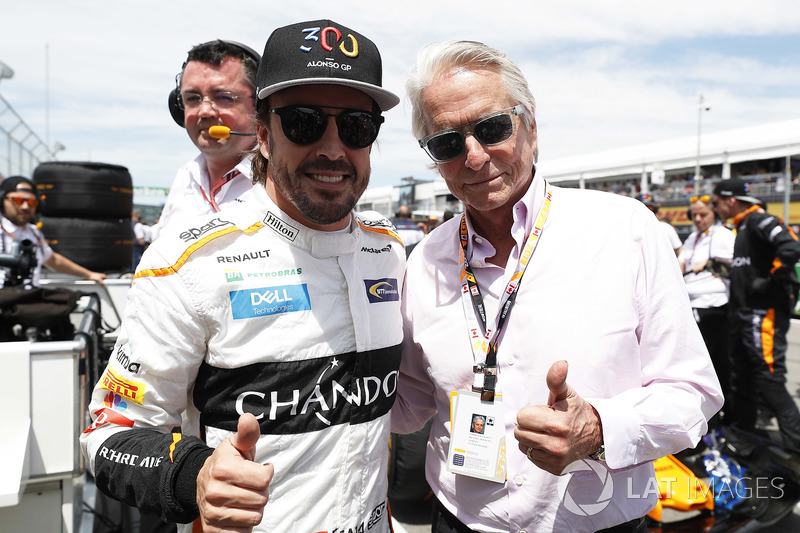 Fernando Alonso, McLaren, and Actor Michael Douglas on the grid