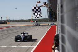 Lewis Hamilton, Mercedes AMG F1 W08, race winner, takes the chequered flag