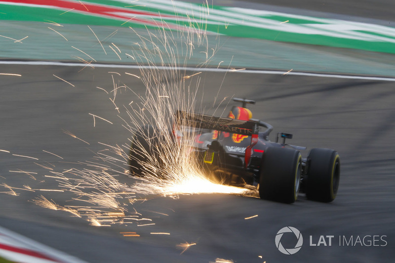 Sparks fly from the car of Daniel Ricciardo, Red Bull Racing RB14 Tag Heuer