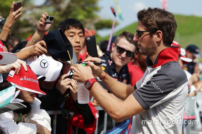 Romain Grosjean, Haas F1 Team signs autographs for the fans