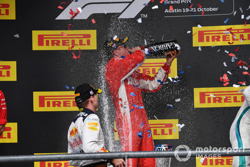 Max Verstappen, Red Bull Racing, Kimi Raikkonen, Ferrari and Lewis Hamilton, Mercedes AMG F1 celebrate on the podium with the champagne