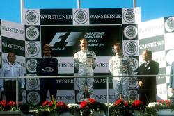 Podium: race winner Johnny Herbert, Stewart-Ford SF-3, second place Jarno Trulli, Prost Peugeot AP02, third place Rubens Barrichello, Stewart-Ford SF-3, Jackie Stewart