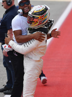 Polesitter Lewis Hamilton, Mercedes AMG F1 celebrates with brother Nicolas Hamilton, in parc ferme