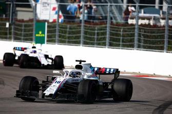 Lance Stroll, Williams FW41, leads Sergey Sirotkin, Williams FW41
