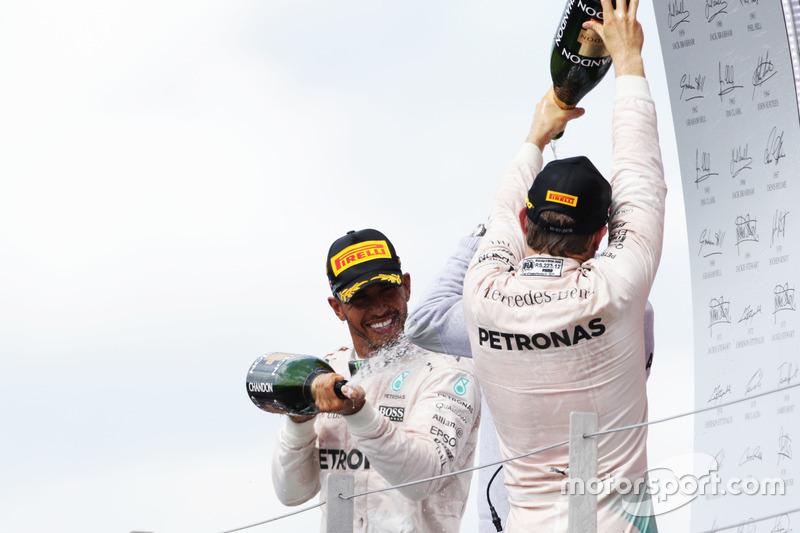 Race winner Lewis Hamilton, Mercedes AMG F1 celebrates on the podium with team mate Nico Rosberg Mercedes AMG F1