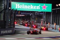 Sebastian Vettel, Ferrari SF16-H follows the field through the pit lane behind the FIA Safety Car