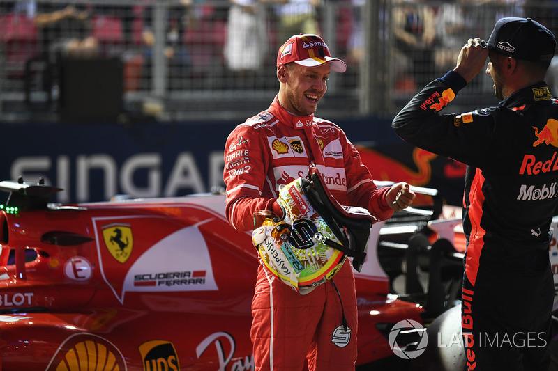 Polesitter Sebastian Vettel, Ferrari; 3. Daniel Ricciardo, Red Bull Racing
