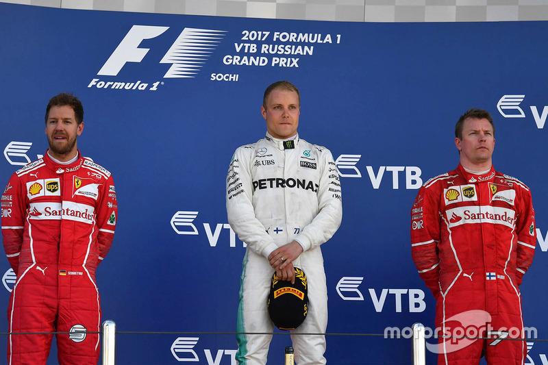 Sebastian Vettel, Ferrari, Valtteri Bottas, Mercedes AMG F1 and Kimi Raikkonen, Ferrari