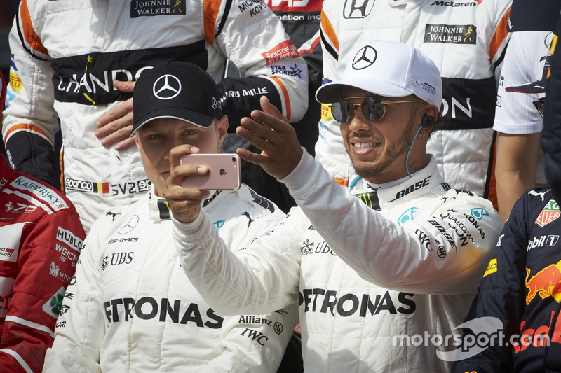 Lewis Hamilton, Mercedes AMG, takes a pic with team mate Valtteri Bottas, Mercedes AMG