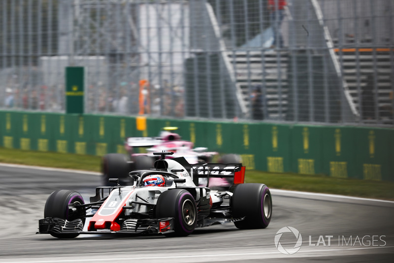 Romain Grosjean, Haas F1 Team VF-18, leads Esteban Ocon, Force India VJM11