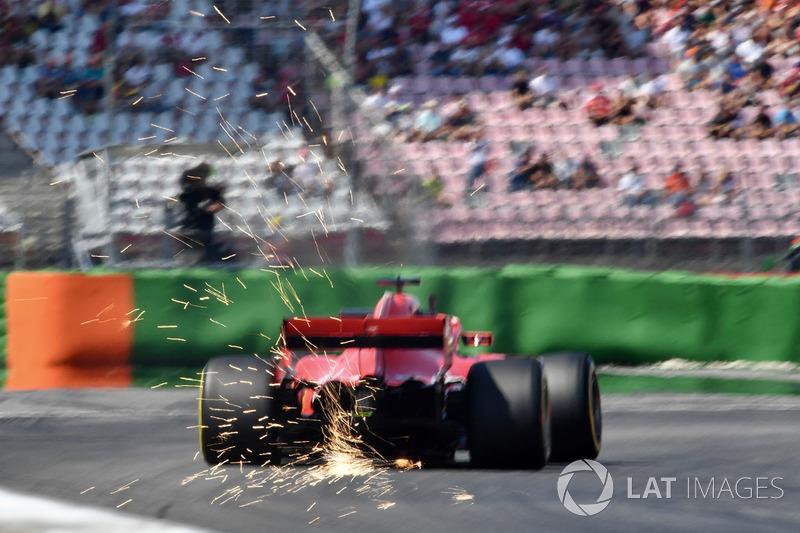 4. Sebastian Vettel, Ferrari SF71H sparks