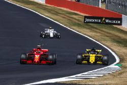 Kimi Raikkonen, Ferrari SF71H and Nico Hulkenberg, Renault Sport F1 Team R.S. 18