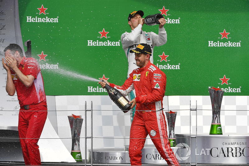 Race winner Sebastian Vettel, Ferrari celebrates on the podium with the chmpagne