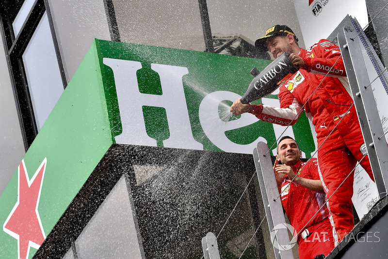 Race winner Sebastian Vettel, Ferrari celebrates with the champagne on the podium