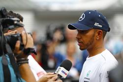 Lewis Hamilton, Mercedes AMG F1, speaks to the media