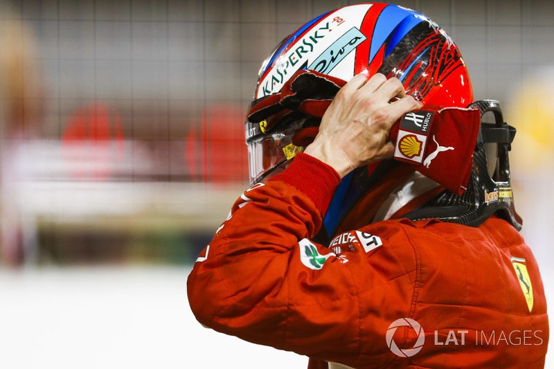 Kimi Raikkonen, Ferrari, takes his helmet off after securing second on the grid in Qualifying