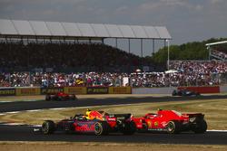 Kimi Raikkonen, Ferrari SH71H and Max Verstappen, Red Bull Racing RB14