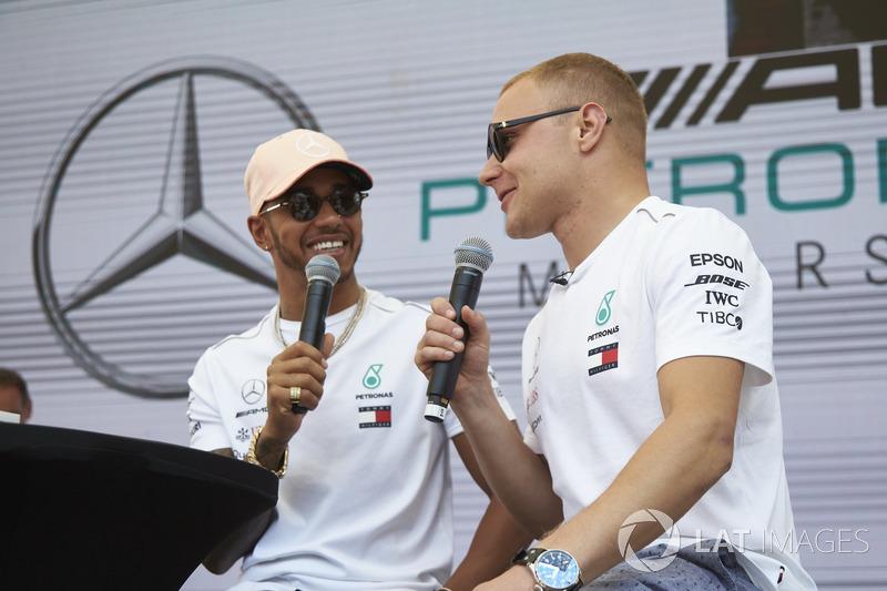 Lewis Hamilton, Mercedes AMG F1s to Valtteri Bottas, Mercedes AMG F1, on stage