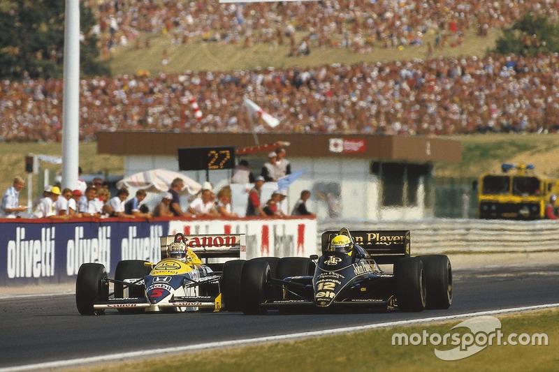 Айртон Сенна (Lotus 98T Renault) обгоняет Найджела Мэнселла (Williams FW11 Honda). Они финишируют 2-м и 3-м соответственно