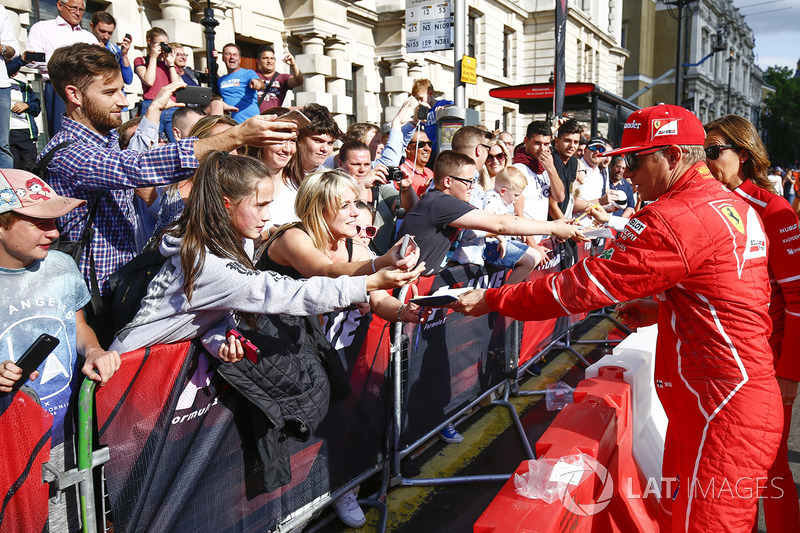 Kimi Raikkonen, Ferrari, signs autographs for fans