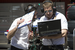 Engineers in the pit lane
