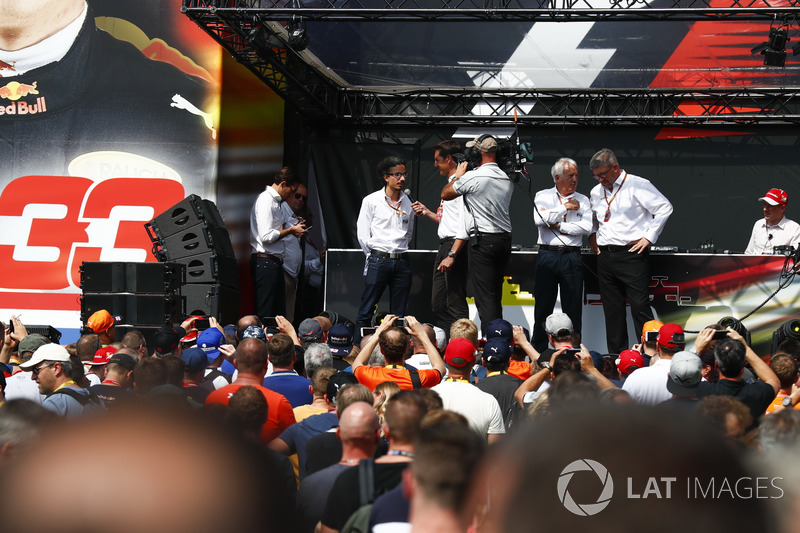 Charlie Whiting, FIA Race Director, Ross Brawn, Managing Director of Motorsports, FOM, other FIA members on stage