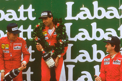 Michele Alboreto, 1st position, Stefan Johansson, 2nd position and Alain Prost, 3rd position on the podium
