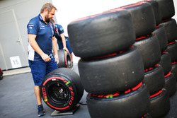 Williams mechanic with Pirelli tyres