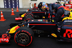 Max Verstappen, Red Bull Racing RB12 and Daniel Ricciardo, Red Bull Racing RB12 climb out of their c