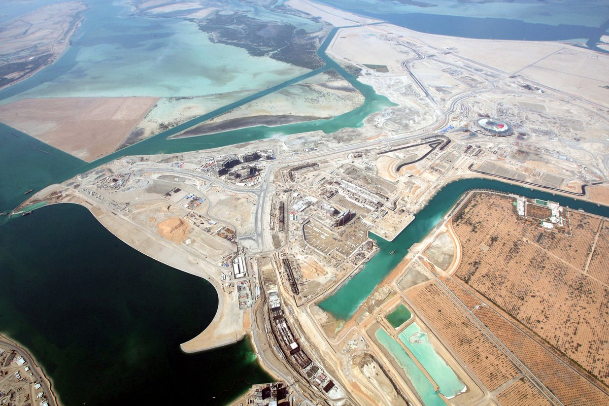 Aerial view of the Marina, Main Grandstand, Pit Buildings, Team Buildings, Marina Hotel, Track, North Grandstand and Yas Island