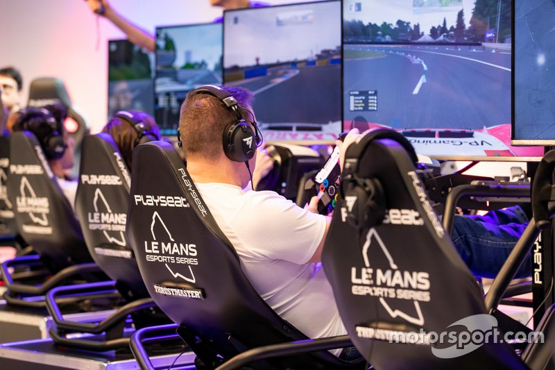 A fan uses one of the Le Mans eSports Series simulator rigs