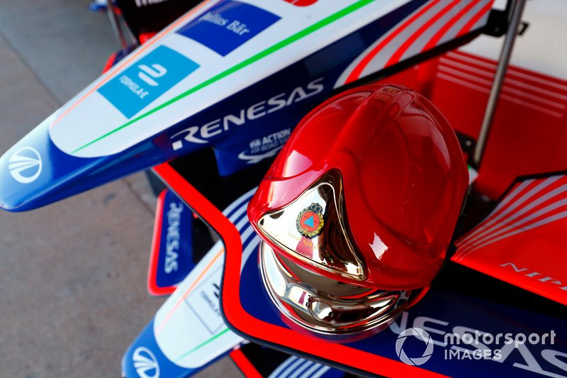 Fireman's helmet on the nose of a Mahindra Racing car