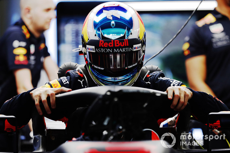 Daniel Ricciardo, Red Bull Racing RB14, climbs in his car in the garage