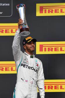 Lewis Hamilton, Mercedes AMG F1 celebrates on the podium on the podium with the trophy