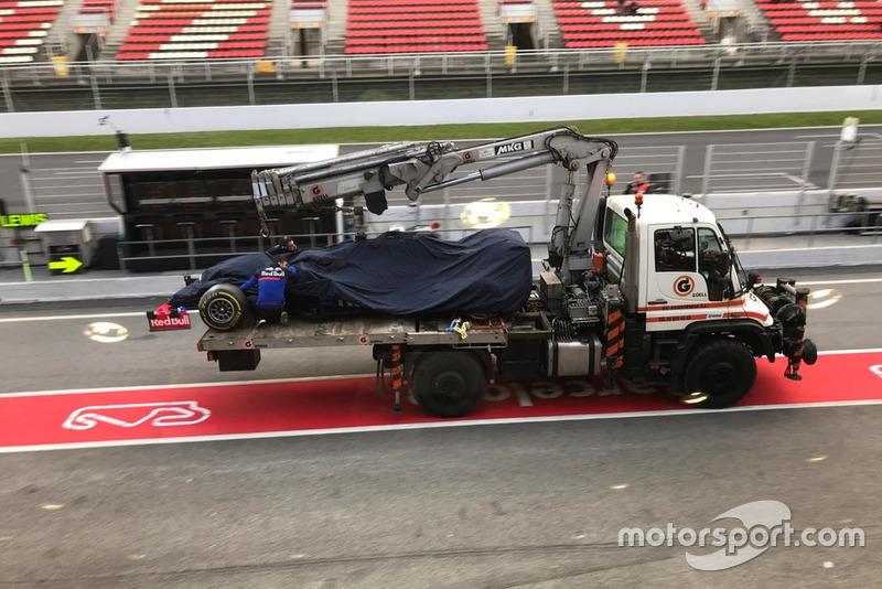 The car of Alex Albon, Scuderia Toro Rosso STR14, on the back of a truck in pit lane