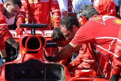 Ferrari mechanics work on the car of Sebastian Vettel, Ferrari SF70H