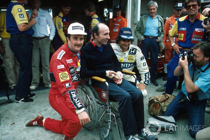 Победитель Найджел Мэнселл, глава команды Williams Фрэнк Уильямс и Нельсон Пике