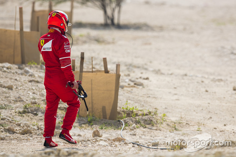 Kimi Raikkonen, Ferrari, walks back to his garage
