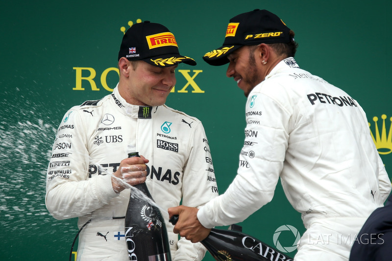 Valtteri Bottas, Mercedes AMG F1 and race winner Lewis Hamilton, Mercedes AMG F1 celebrates on the podium, the champagne