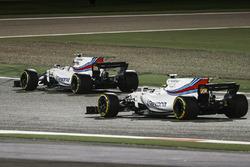 Felipe Massa, Williams FW40, passes the stopped car of team mate Lance Stroll, Williams FW40