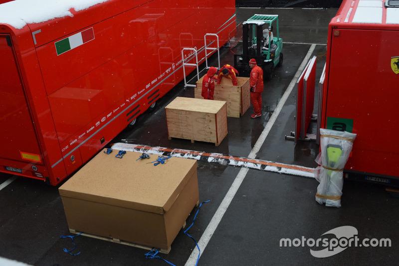 Ferrari team members in the paddock